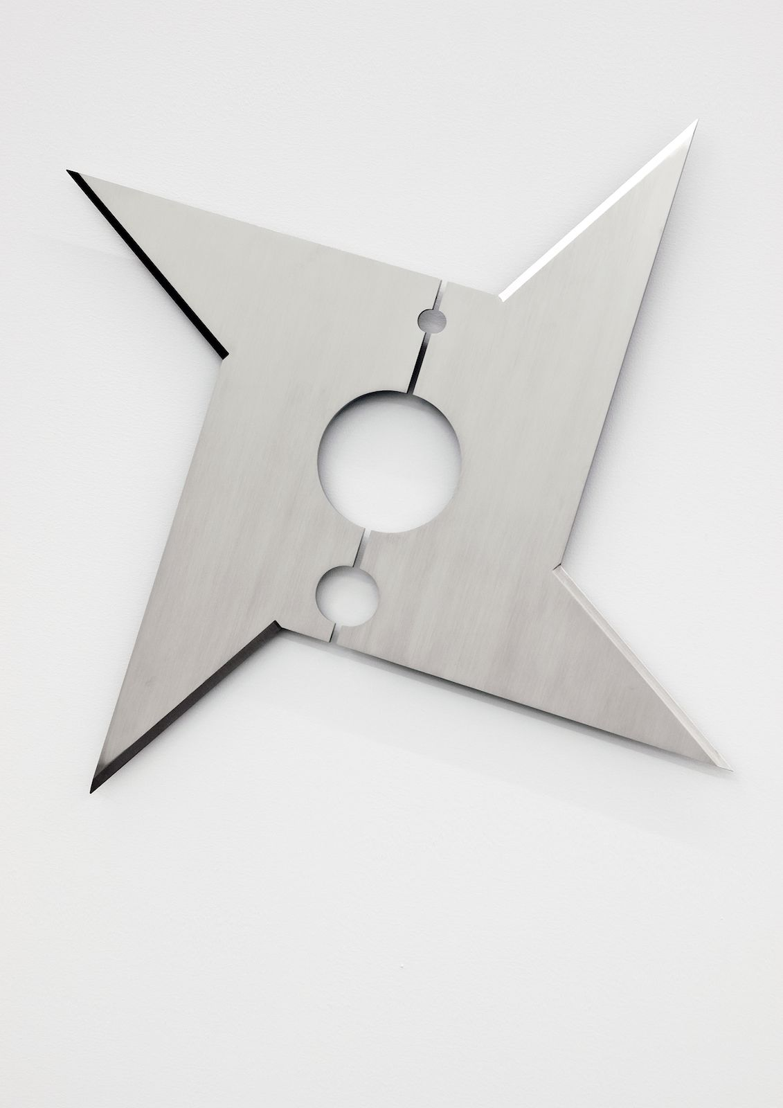 Kristina Matousch, Cutting Cunt, 2010, laser cut stainless steel, 75 x 52 x 2 cm
