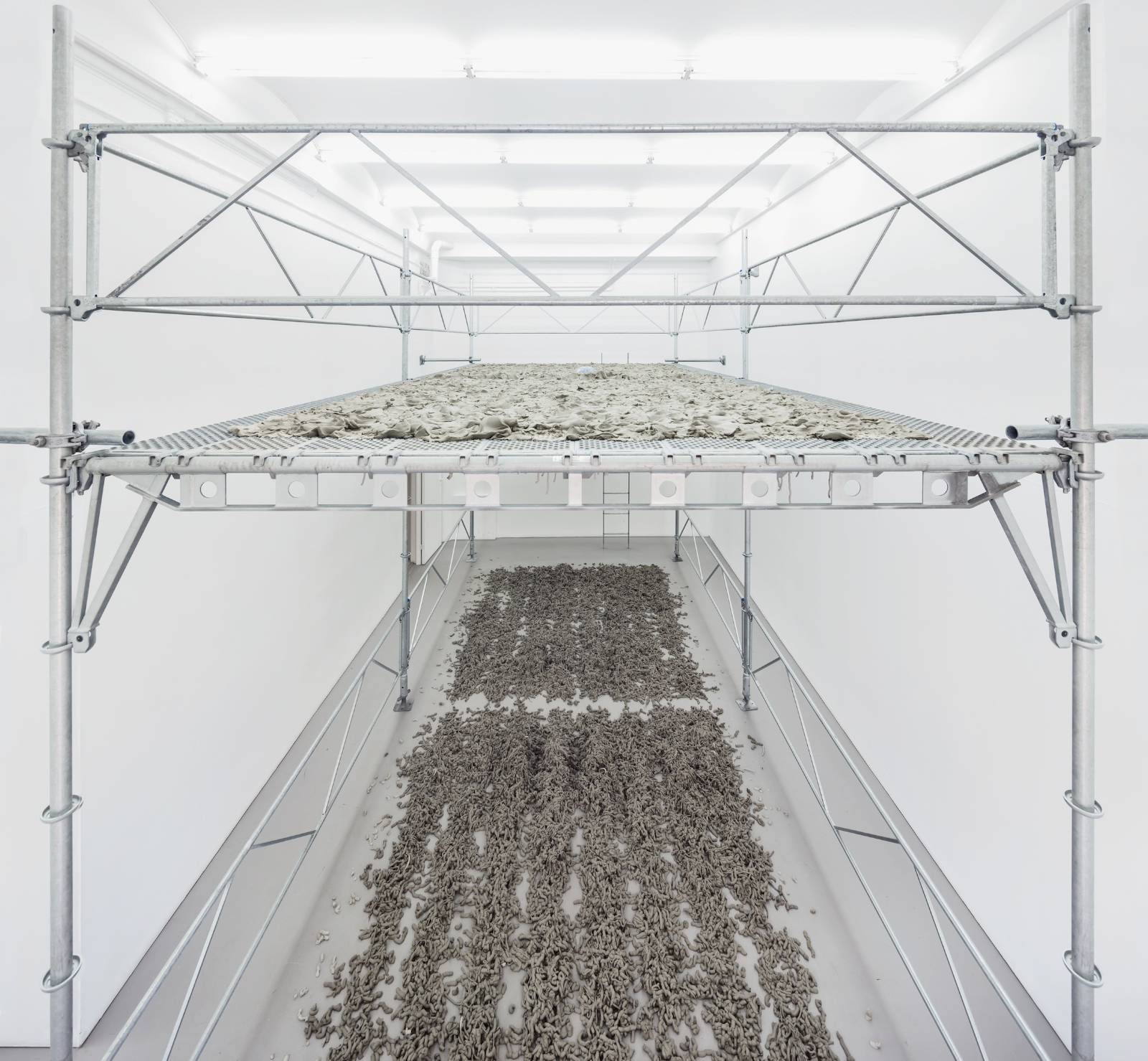 Kristina Matousch, Still Life Production, 2013, performance, scaffolding, steel planks, clay, 3 x 6 x 4 m