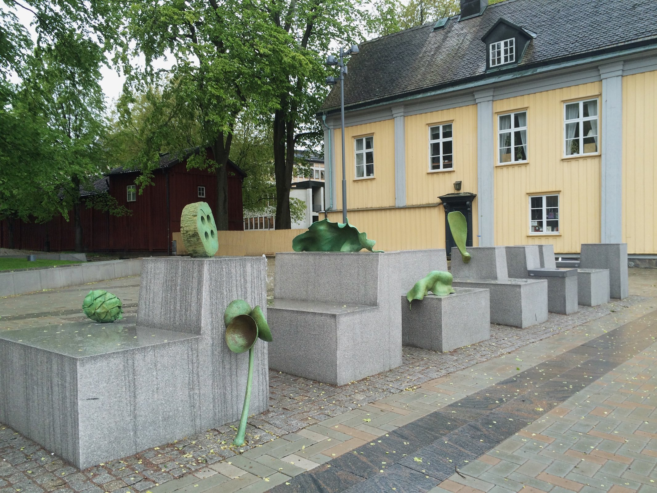 Carl Boutard, River Walk, 2015, comissioned by Karlstad Municipality. A site specific permanent installation in public space consisting of enlarged fragments of nature. In themselves insignificant these minuscule objects were found and carefully chosen by the artist during strolls along the adjacent Klarälven river. One of the bronze sculptures is situated 25 feet up in an elm tree. It was modelled with maple trees cut down while renovating the site.